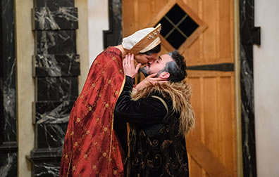 Production photo by Marek K. Photography of Hermione kissing the kneeling Leontes